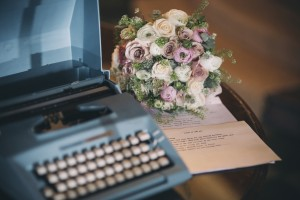 Typewriter and wedding bouquet