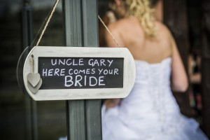 Bride by novelty sign