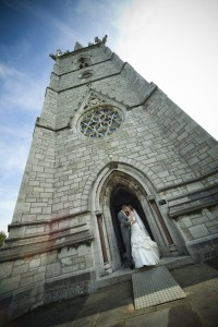 Bride and groom outside of church