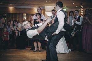 Groom and best man do a fun dance