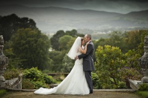 Bride and groom in front of trees