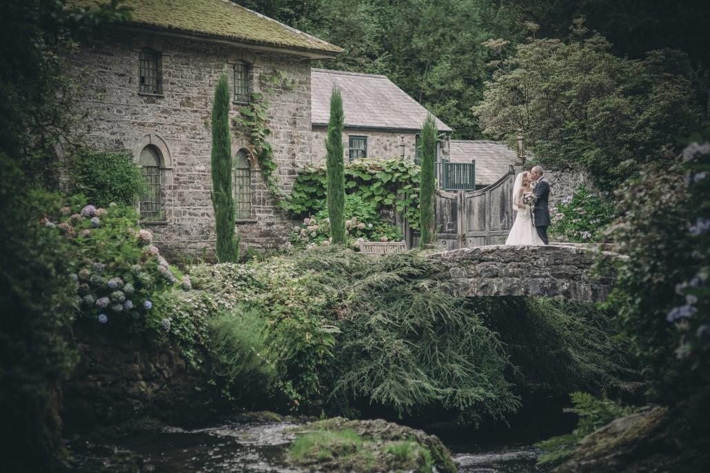 Bride and groom on old style bridge