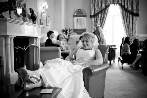 Bride sitting with her feet up