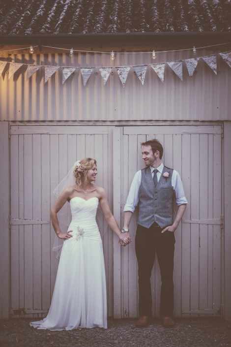 Bride and groom in front of panels and bunting